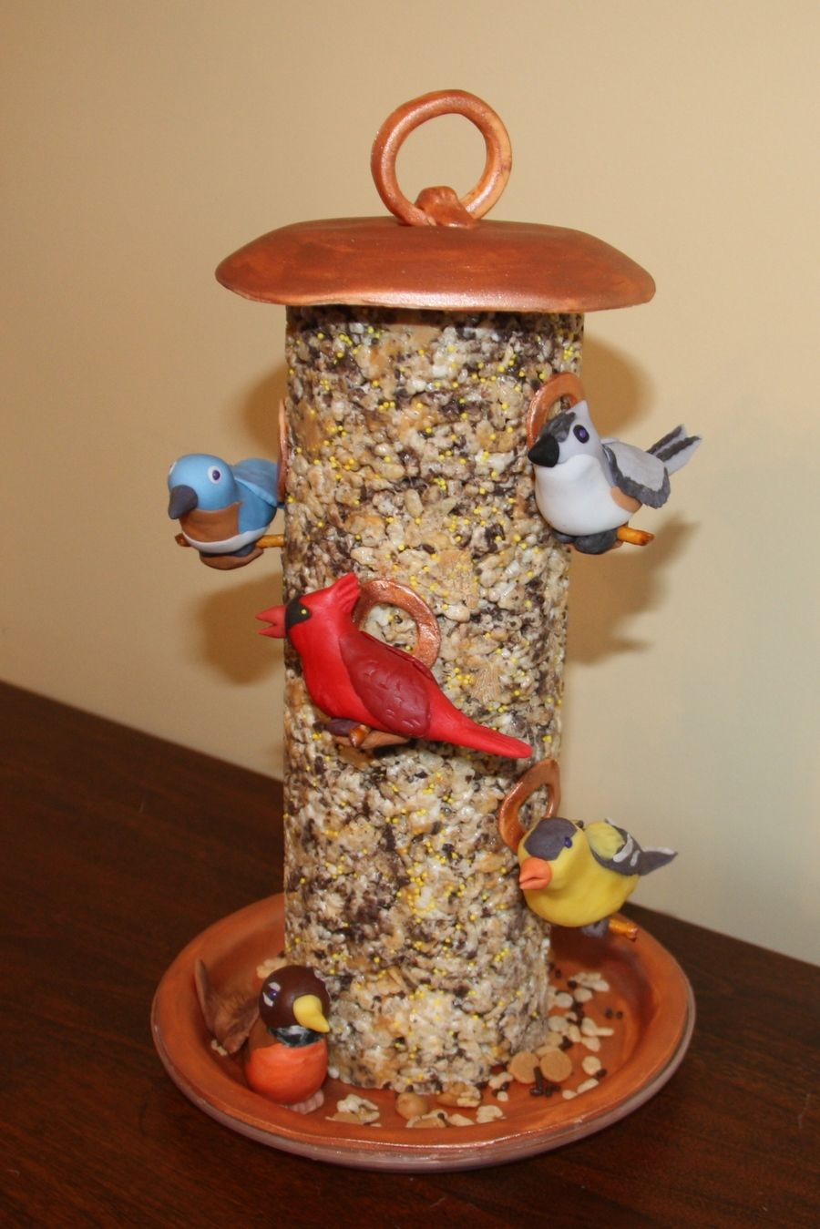 Bird feeder this cake is made of rice krispie treats mixed