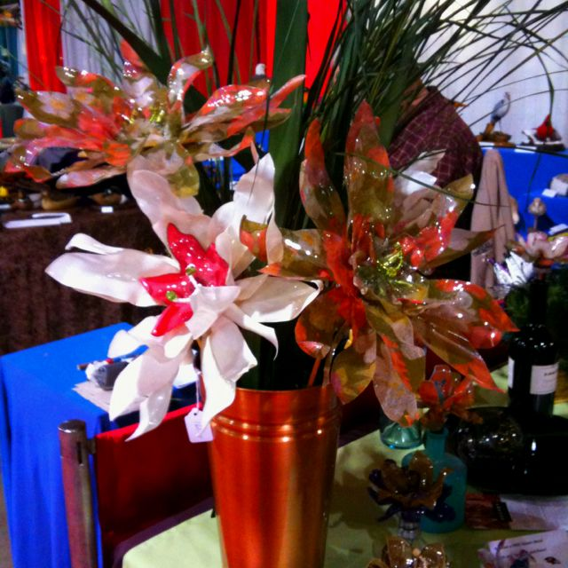 Flower arrangement made from upcycled water and soda bottles
