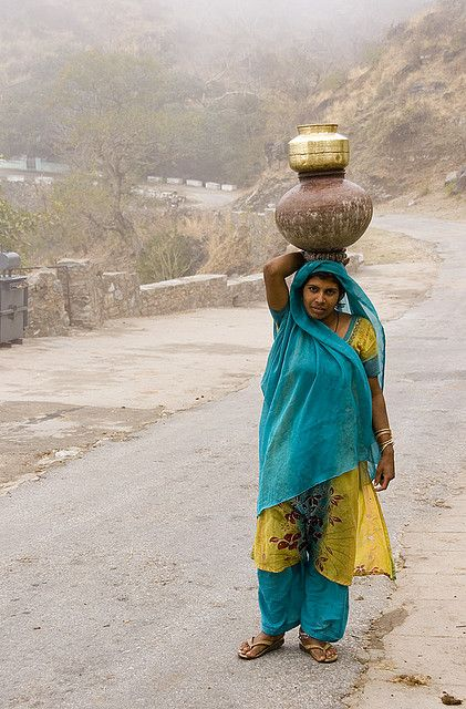 Woman carrying pots by Dey, via Flickr
