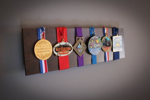 cool way to display medals--would be so easy to make (erm, well, have the hubby make)