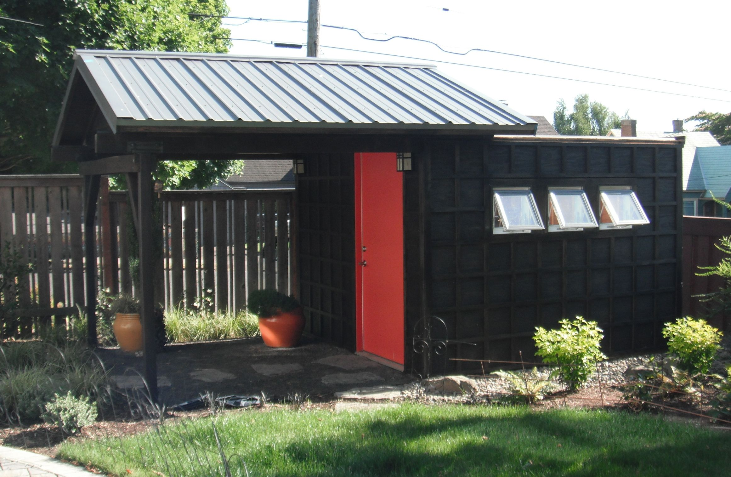 backyard office shed the exterior has a geometric pattern