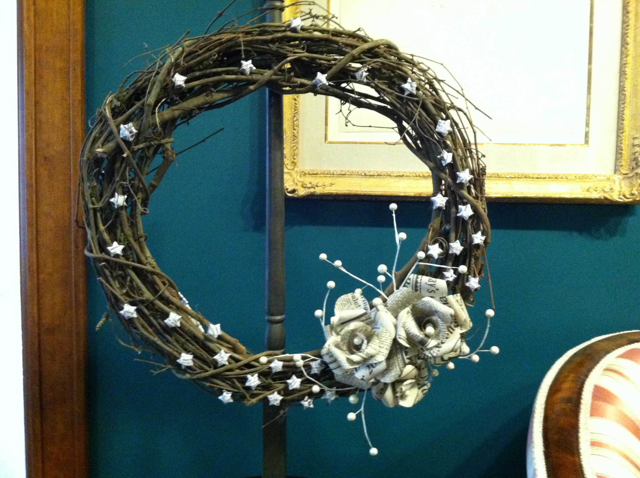 """""""Vintage News"""" Wreath donated by          Muscatine Journal created by Amber Wittmer"""