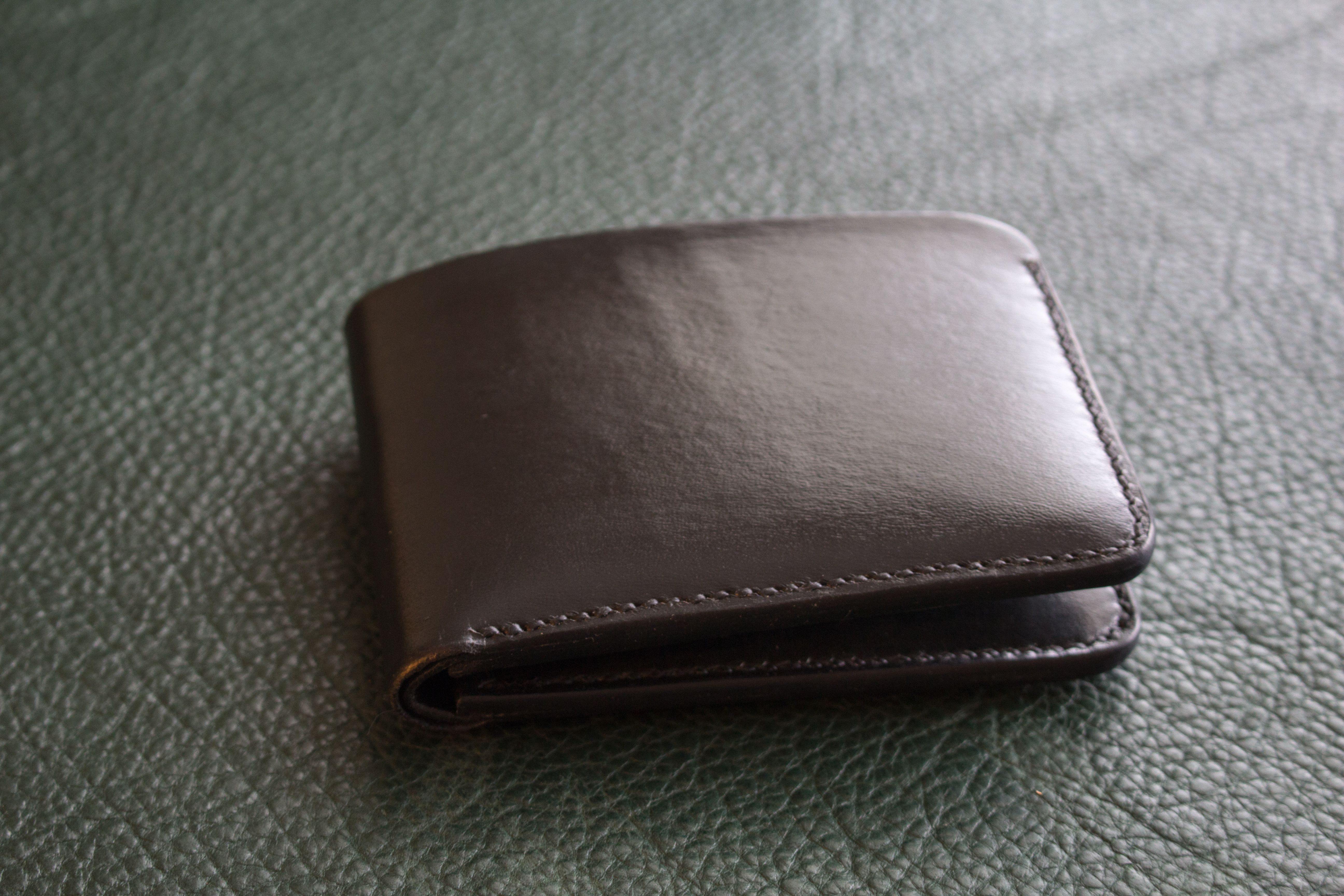 Black veg tan leather bifold #wallet. Hand dyed natural Veg Tan leather. 4 card slots, 2 hidden pockets behind, and a full length bill slot.