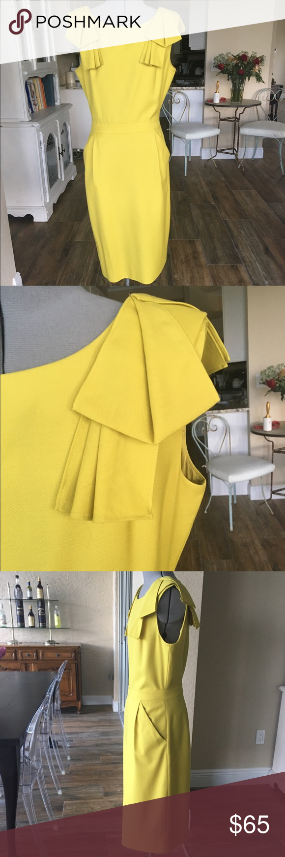 J Crew origami bow sleeve dress This dress is beautiful! It is fitted through the waist and straight to the knee. The bow sleeves make this so interesting and classy. Wear year round. You know you need this! J. Crew Dresses Midi