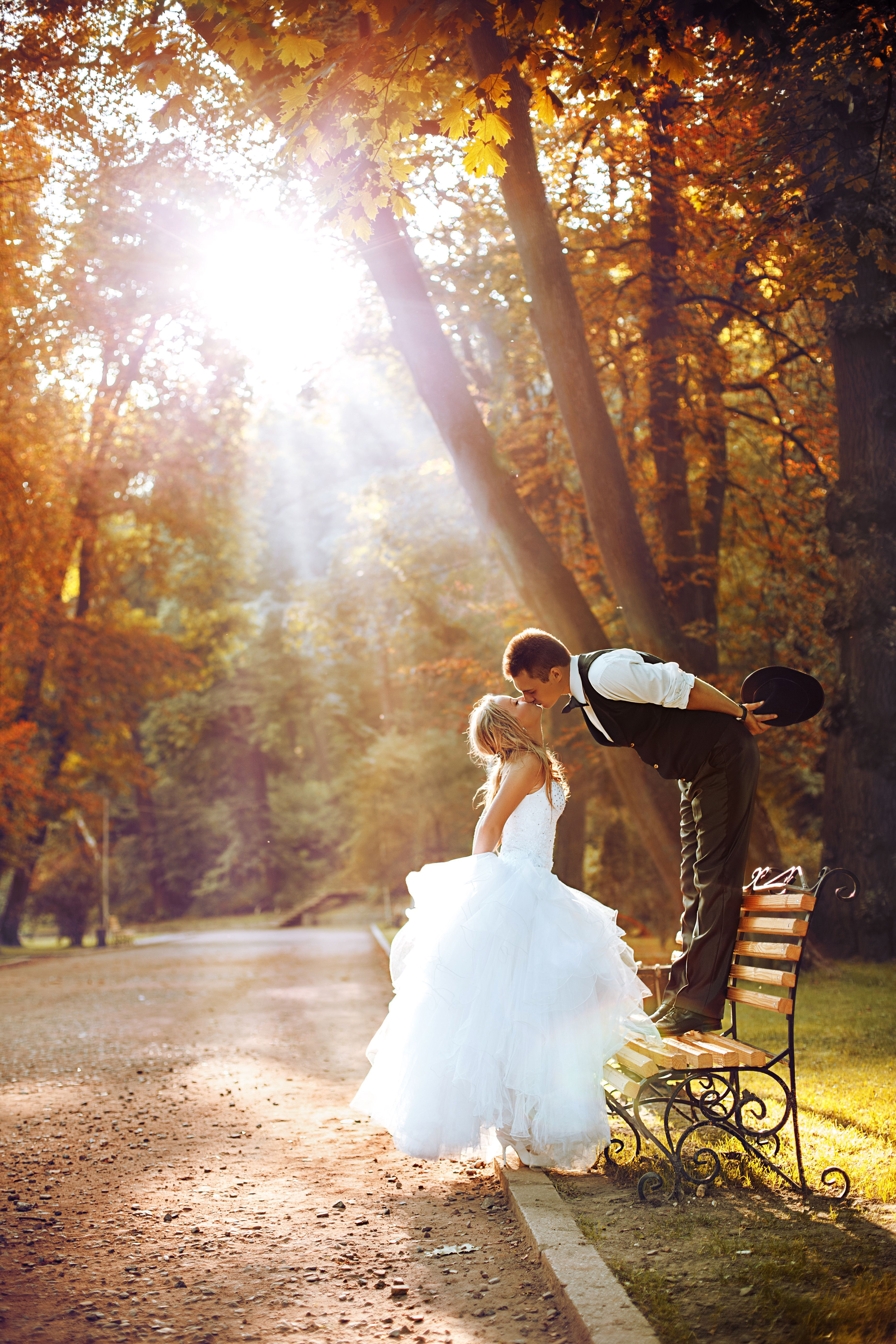 European bride and groom kissing in the park baby shower ideas