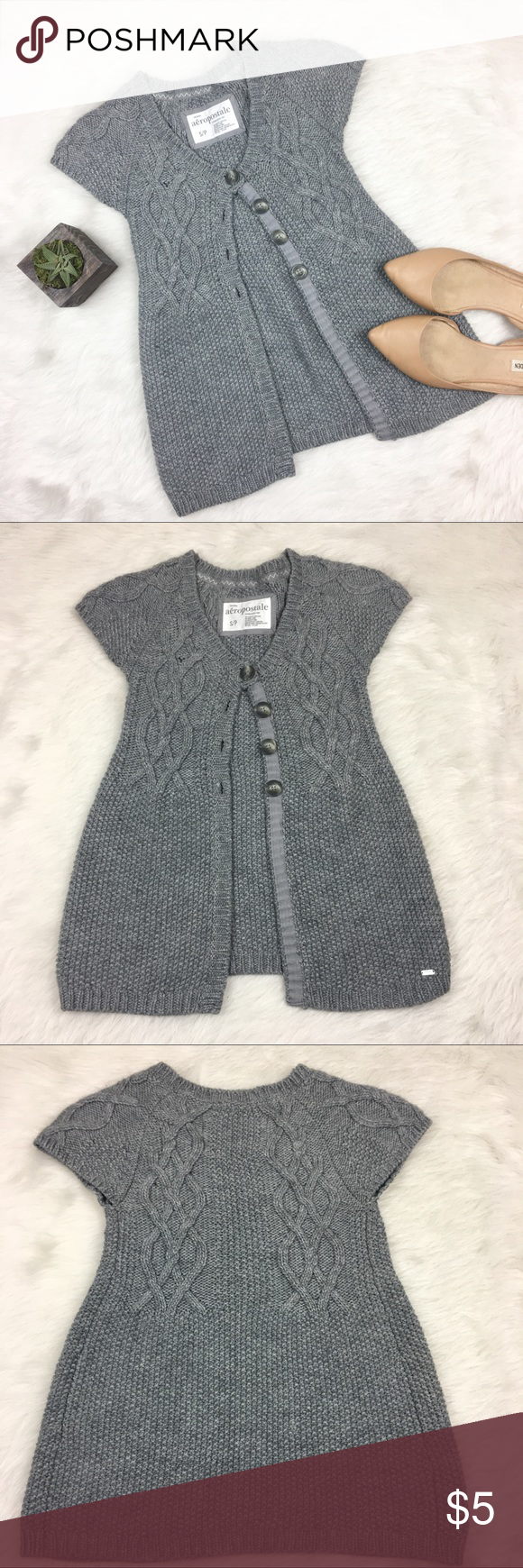 Aeropostale Gray Cap Sleeve Cardigan Aeropostale gray cap sleeve cardigan. Size small. Fits more like an xxs or XS. Approximate measurements are 23' long and 12' bust. GUC with one small place in knots that's pulled apart like a hole. ❌No trades ❌ Modeling ❌No PayPal or off Posh transactions ❤️ I 💕Bundles ❤️Reasonable Offers PLEASE ❤️ Aeropostale Sweaters Cardigans