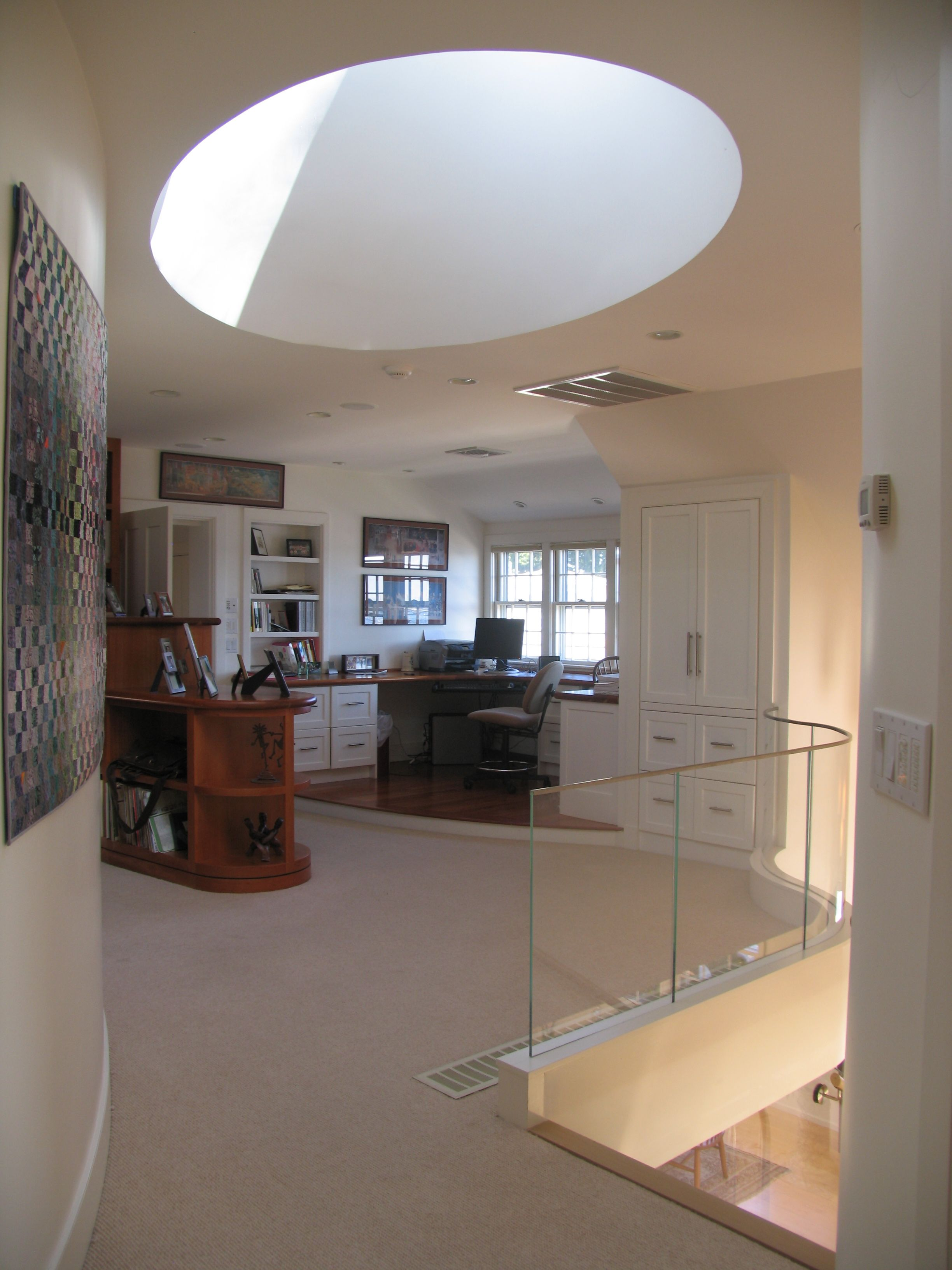 Oval Skylight and Second Level Home Office by Michael McCloskey Design Group