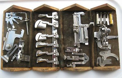 12 Singer Sewing Machine  Box with attachments