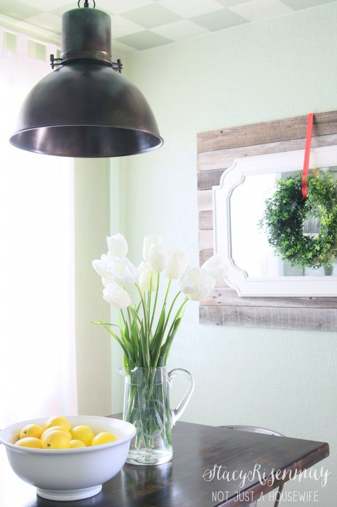 Beautiful dining room update! mirror detail, light detail, flowers, bright and airy