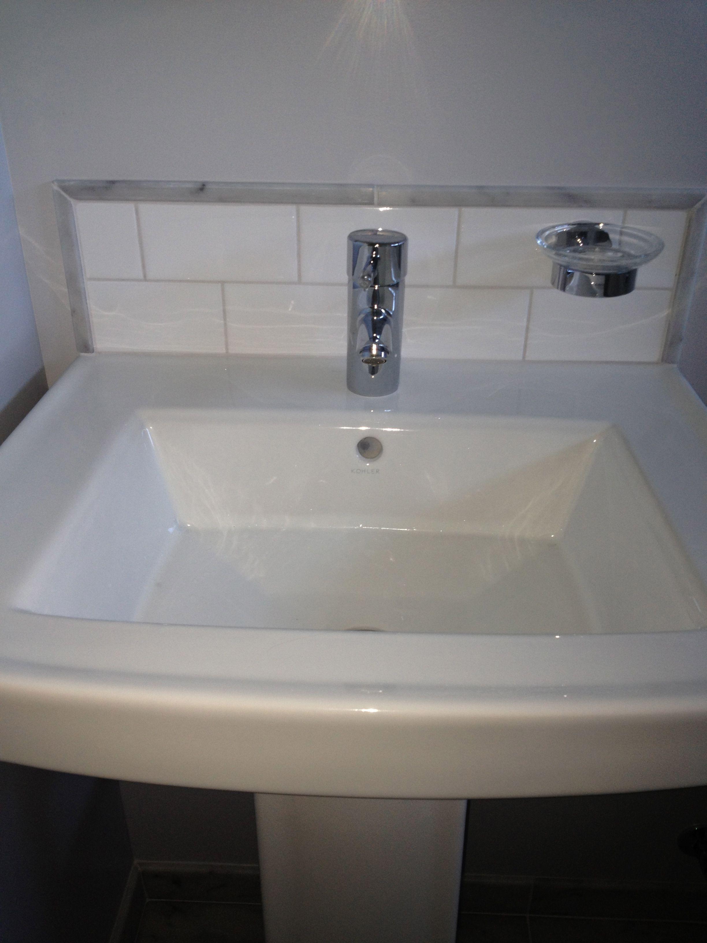 Pedestal Sink With Custom Back Splash Subway Tile With Marble