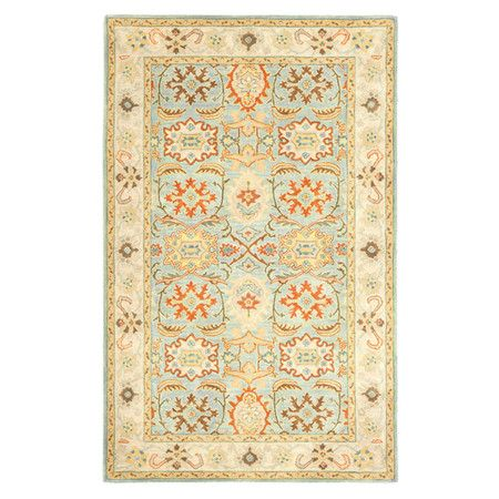 Anchor your living room seating group or define space in the den with this artfully hand-tufted wool rug, featuring a Persian-inspired motif for classic appe...