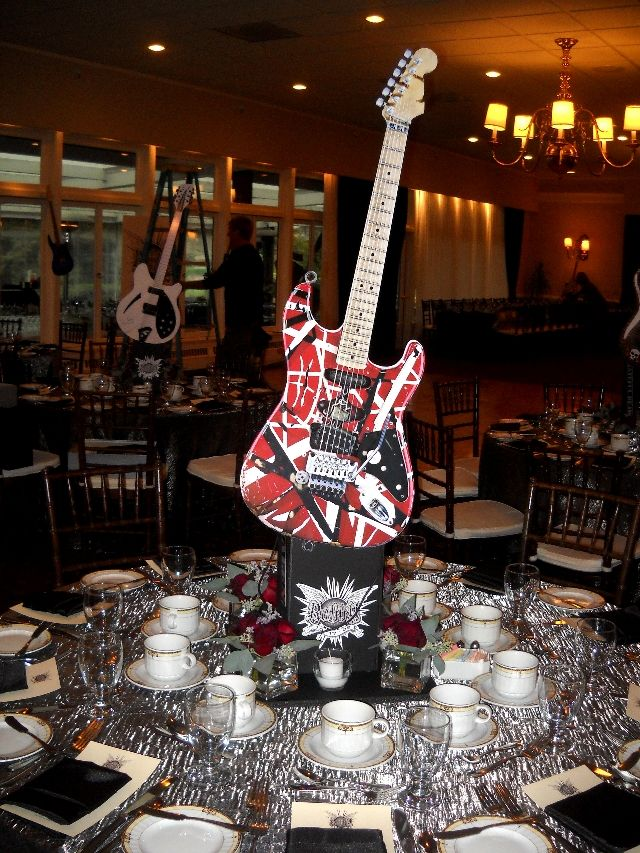 Guitar table centerpieces ronnie wood exhibit party - Rock and roll theme party decorations ...