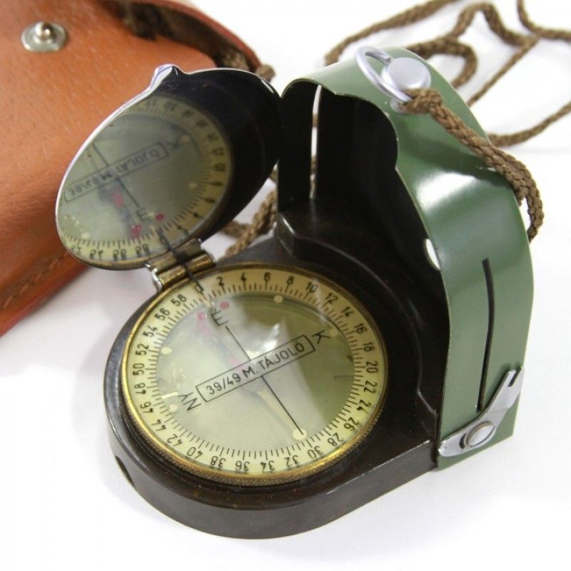 Hungarian Military Compass with Pouch Compass coming from inventory of Hungarian troops. Made of high quality metal. Equipped with a mirror, sights, movable dial and leather pouch. The housing has an additional scale in centimeters, perfect for operations on the map. These are used, needles are still rotating okay, styles of case may vary, may have bubbles inside too.