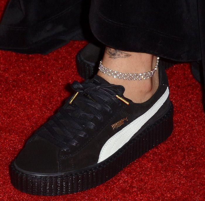 9e03ebfa793 Rihanna walks the red carpet in Fenty Puma Creepers at the Footwear News  Achievement Awards on November 29
