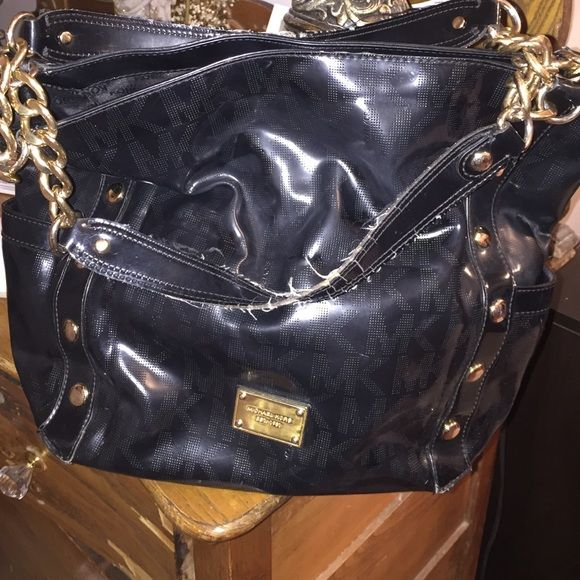 Authentic Michael Kors black tote! In really good condition! Rarely used. Small tear on the side as pictured. Inside in outstanding condition except the straps are a little worn out. Michael Kors Bags Totes