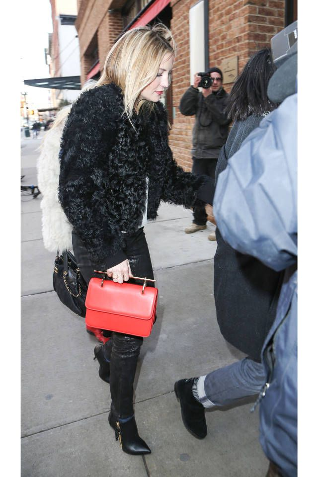 Kate always looks good! Kate Hudson's chic all-black instincts—in leather skinnies and a Rebecca Minkoff sweater—match our current mood as well, but the blonde lends a vibrant dose with a coral M2Malletier bag.