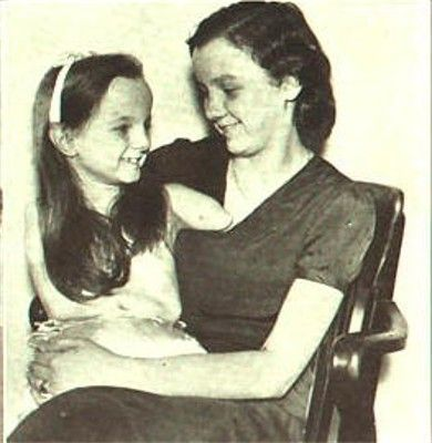 Freida Pushnik, born without arms or legs (seen here at age 9 with her mother) started exhibiting herself as a curiosity with Robert Ripley's Odditorium.