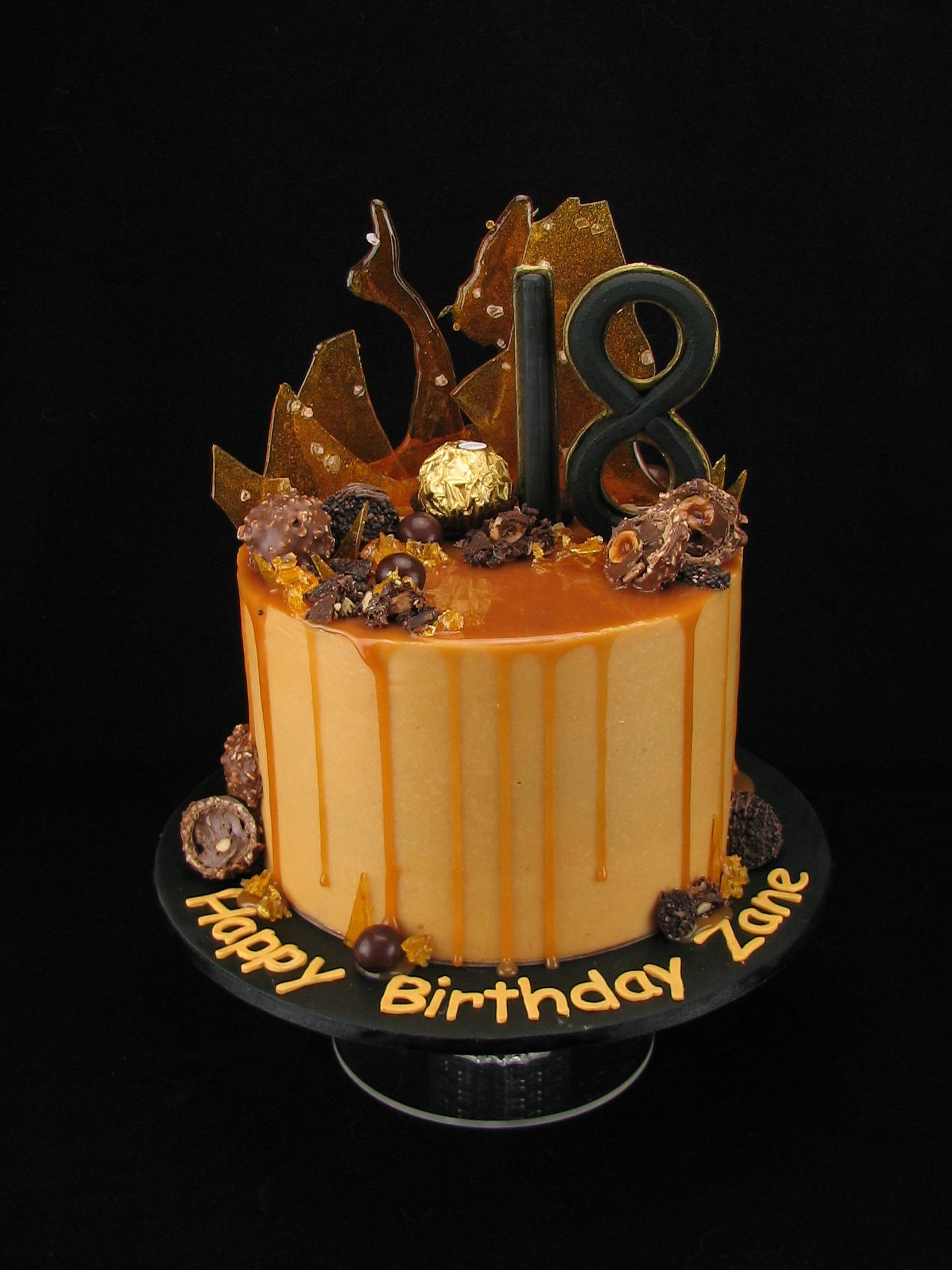 Caramel Mud Cake With Salted Ercream And Sauce Dripping Over The Edge This Decadent Has Been Decorated Ferrero Rochers