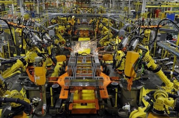 U.S. third-quarter productivity beats forecasts; pay increasing  Robotic arms spot welds on the chassis of a Ford Transit Van under assembly at the Ford Claycomo Assembly Plant in Claycomo, Missouri April 30, 2014.  REUTERS/Dave Kaup