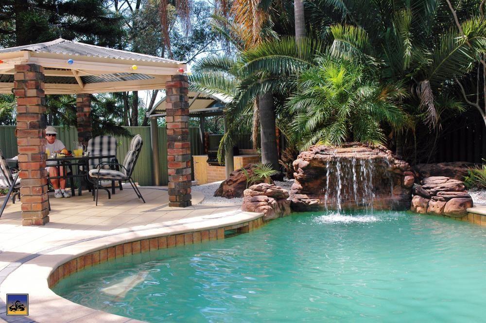 Complete pool waterfall setup Backyard Landscaping Ideas