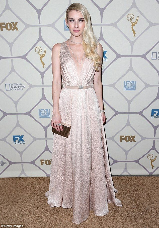 Ready to party: Emma Roberts, 24, wore a pale pink satin gown with a Grecian-style bodice ...