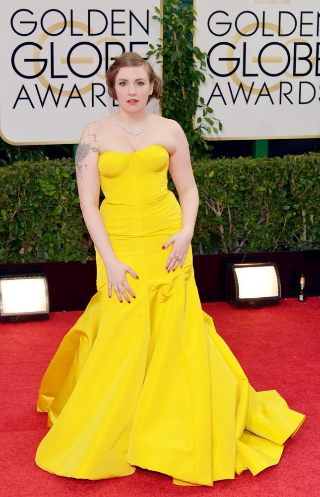 Poor Lena Dunham, this yellow dress by Zac Posen looked as if it was forced on her. Can she breathe in that? This doesn't do her justice; the bight color does not help her complexion. Girls like Lena who have a light skin color should lean towards a more darker range of color rather then light. The dark colors complements the light tone of the skin color, while bright color make one seem washed out. If the dress was darker and a bit looser around the chest, the malfunction would not have…