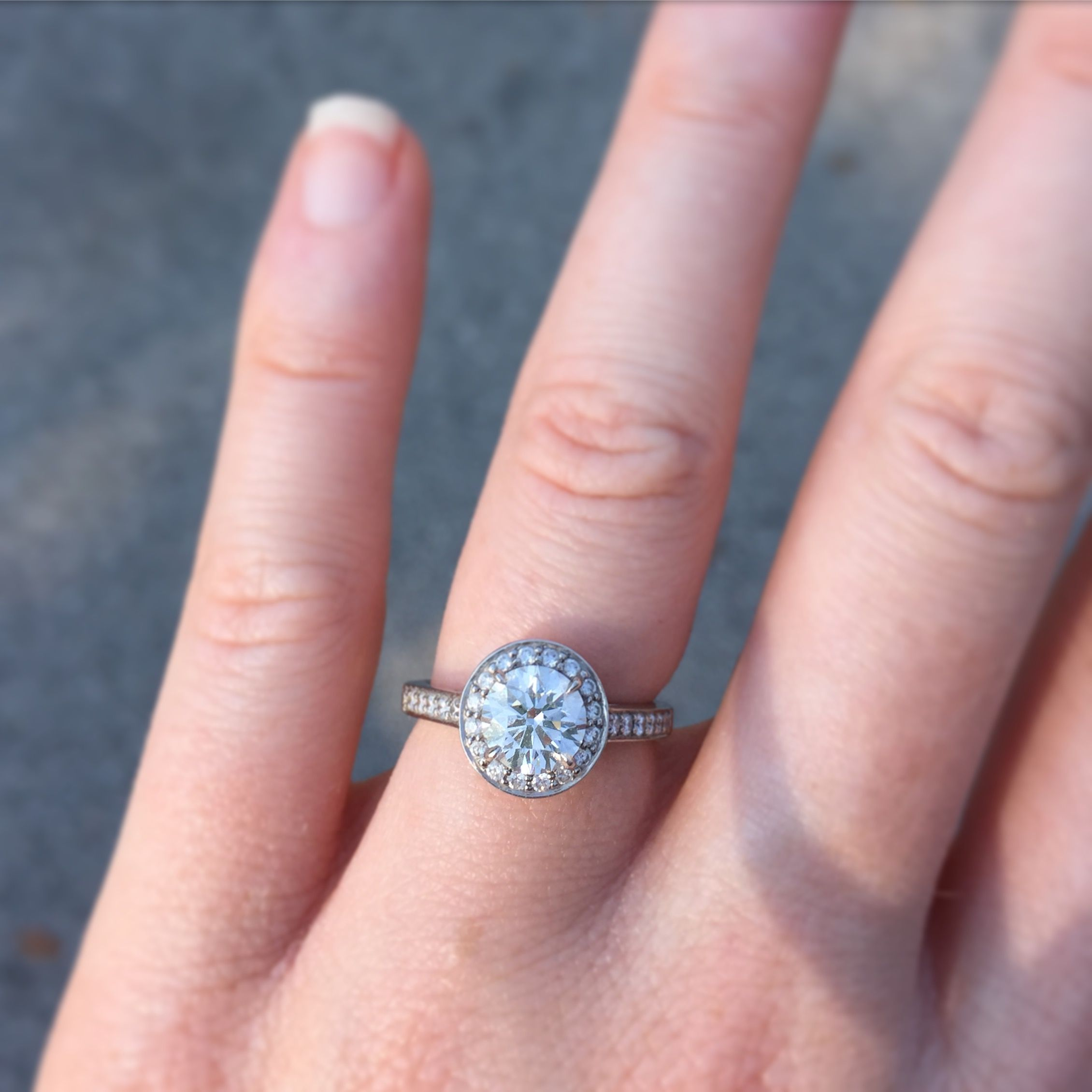 Tiffany Embrace. Center stone: .92 carats, H, VVS2. Halo and band ...