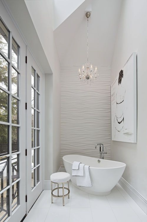 soaking tub with wavelike wall panel textured bathroom tile white bathroom