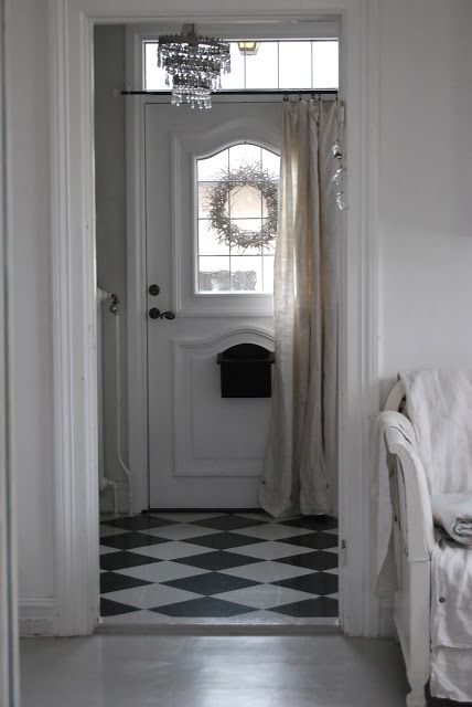 Hang A Curtain Over The Front Door To Prevent Drafts And Provide