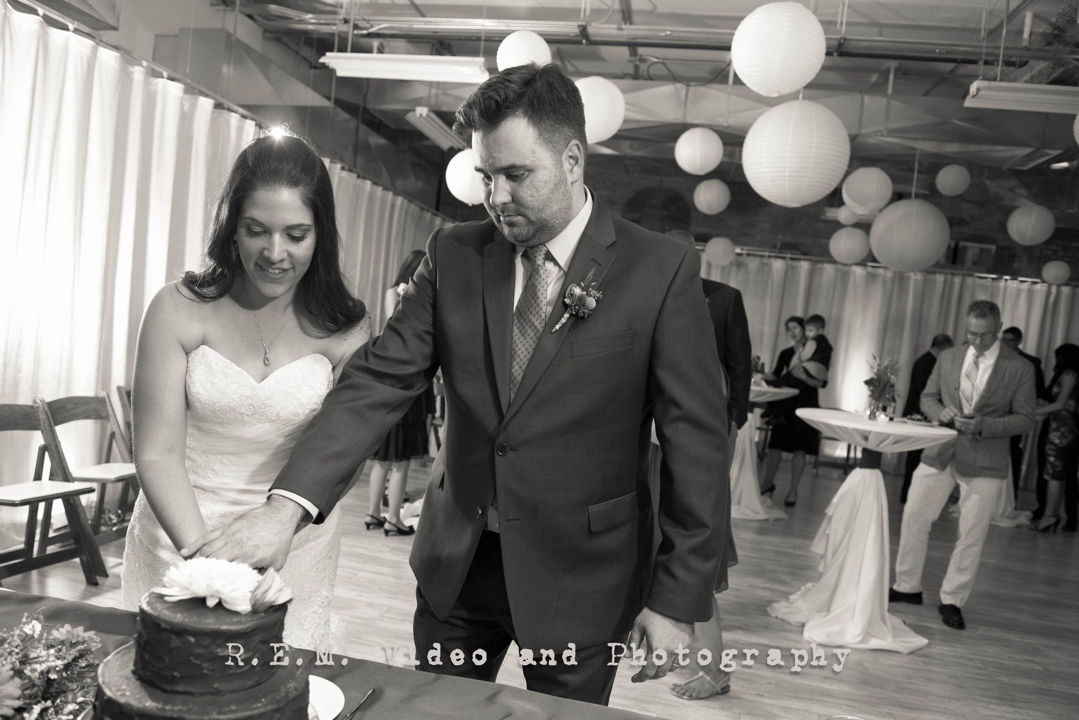 The first cut of their cake. R.E.M. Wedding. www.remvp.com
