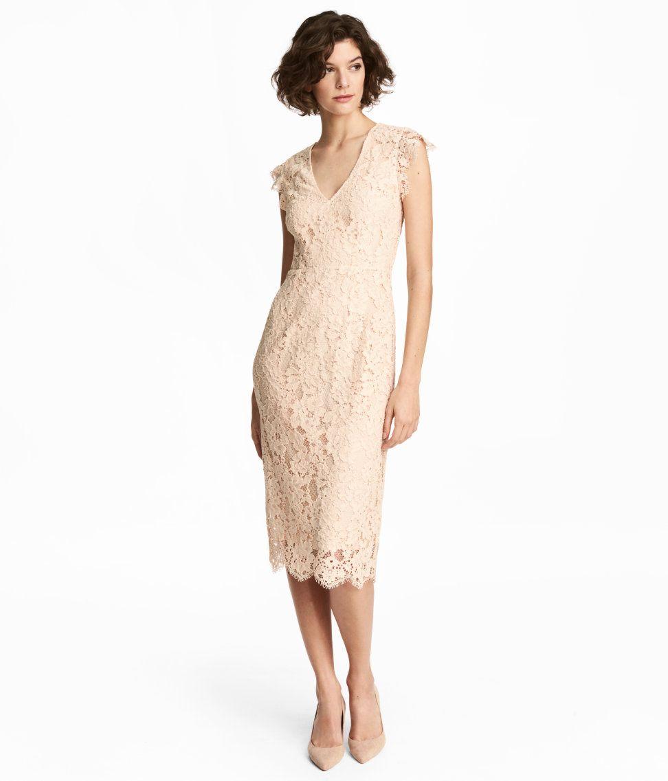 a06e4a05bb49 Light beige. Knee-length lace dress with a V-neck
