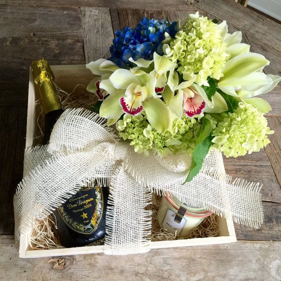 champagne and flowers gift crate