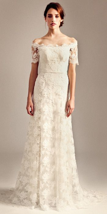 TEMPERLEY BRIDAL FALL 2014: Off the shoulder corded lace dress with scallop lace edges at neckline and subtle flowing train.