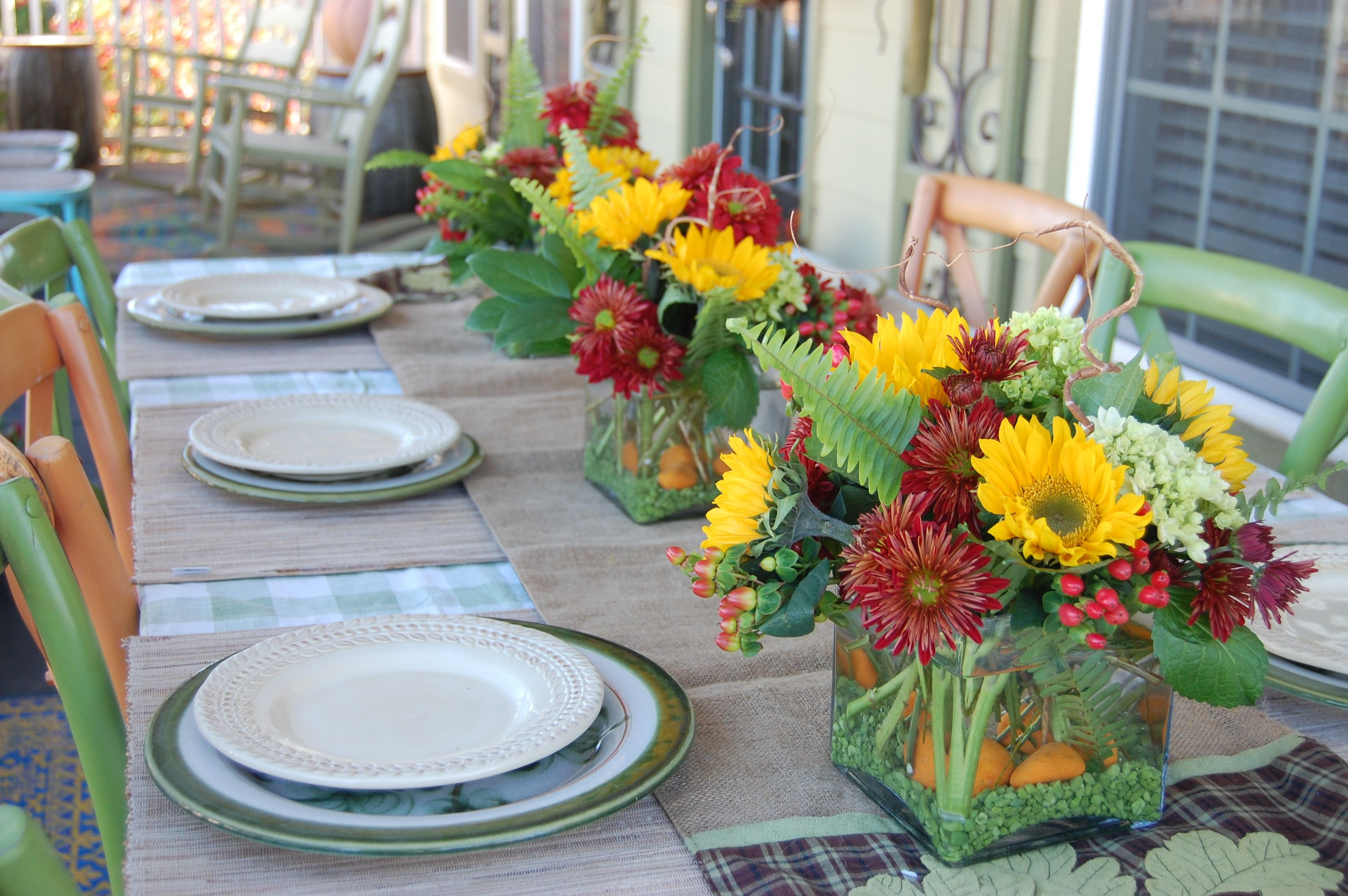 fresh flowers make for the centerpieces on outdoor dining