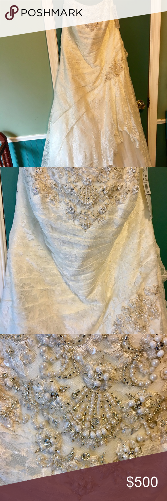 BNWT Davids Bridal size 20 wedding gown Absolutely gorgeous ivory lace David's bridal gown with amazing intricate beading. Brand new, never worn or altered. This dress is selling for $849 in store right now. Pictures do not do it justice. It is a size 20W...it has a corset back so it can go up or down a size or two (pardon lacing job shown, I just laced it quick for picture). The dress is strapless and has a gorgeous train. David's Bridal Dresses Wedding