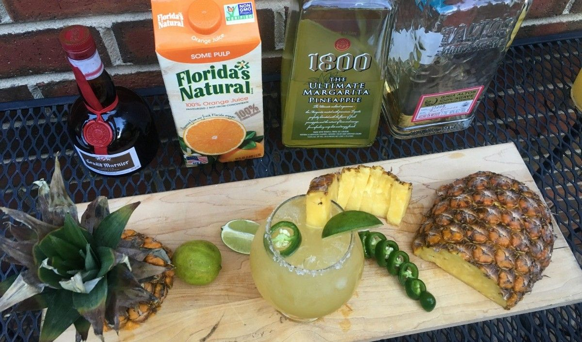 It's almost the weekend! Try this margarita with a kick to start your weekend off right!  Ingredients For the rim:   2 tablespoons kosher salt  2 tablespoons Grand Mariner  For the margarita:   2 cups ice  16 oz. 1800 Ultimate PineappleMargarita  1