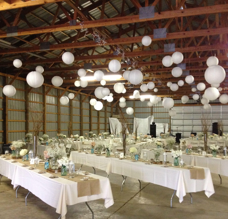 Barn wedding DIY hanging paper lanterns burlap runners long