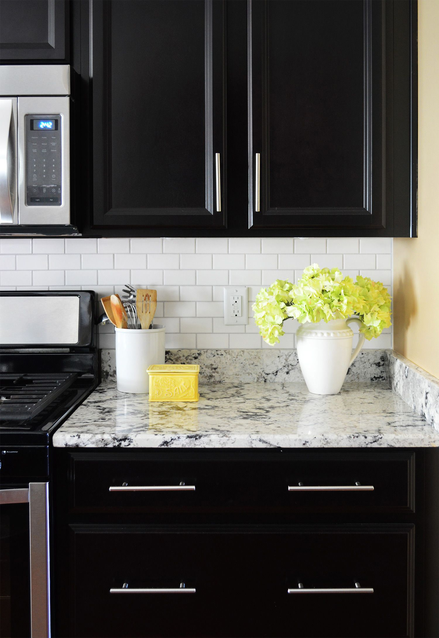 How To Install A Subway Tile Kitchen Backsplash Young House Love Subway Tile Backsplash Kitchen Backsplash With Dark Cabinets Black Kitchen Cabinets