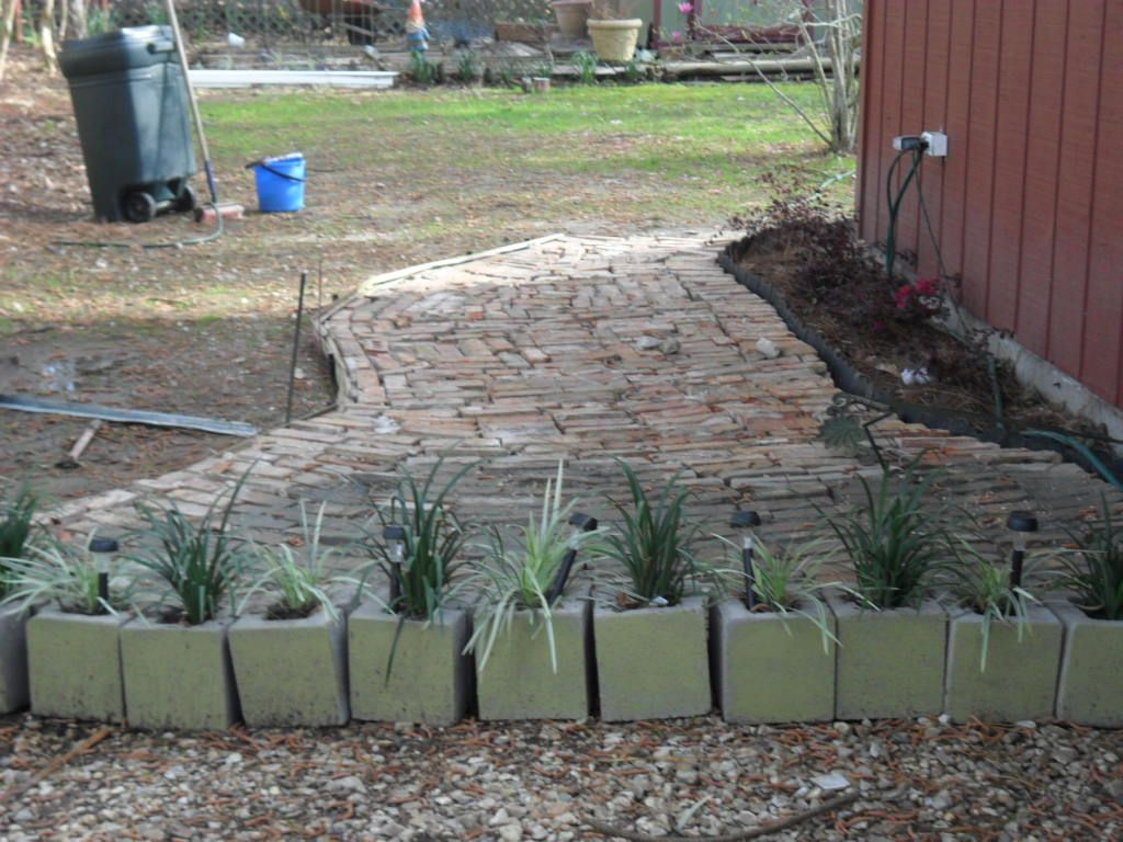 Used cinder blocks to create an opening from rock garden to brick