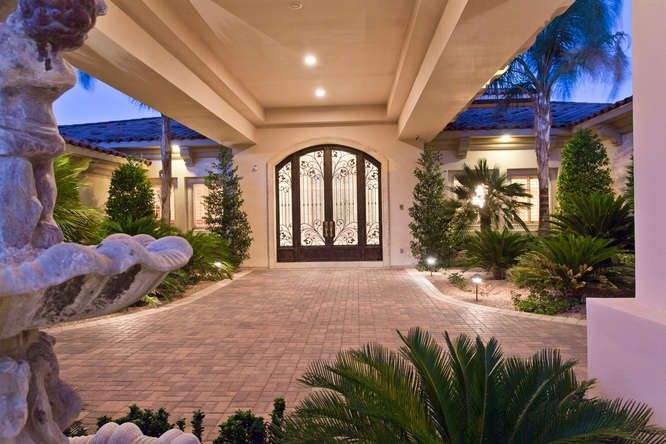 A fun door for porte cochere porte cochere pinterest for Courtyard driveway house plans