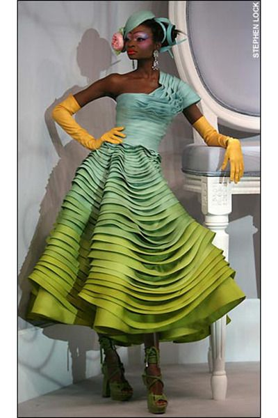 Galliano, 2011 ~ chartreuse Dior dress, with turquoise Dior hat, orange Galliano gloves, and    chartreuse Galliano heels.