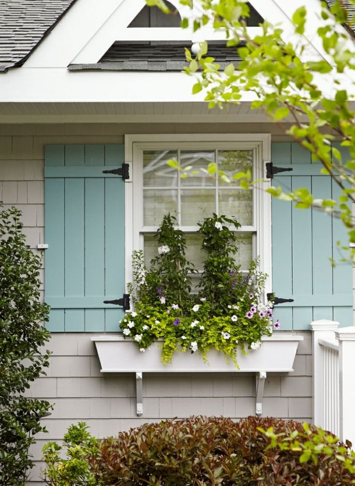Nantucket beach cottage exteriors in the garden 21 for Cottage style exterior shutters