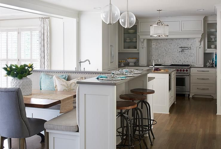 Beautiful kitchen features a white kitchen island topped - Kitchen island with bench seating ...