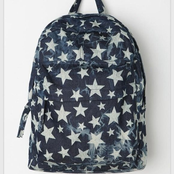 """Star Print backpack Cotton backpack topped with a faded star pattern. Front pull-zip pocket keeps all your essentials handy. Lined interior with 2 open pockets & a zip pocket. Padded, adjustable shoulder straps. Sturdy hang-loop at the top. Compact construction. Soft n' slouchy. Measurements: 12.5""""l, 5.25""""w, 16""""h. Content & Care: Cotton, polyester, plastic, mixed metal. Spot clean. Imported. Accessories"""
