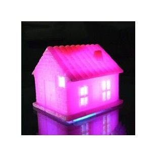 This house is made of wax and is not a candle, but it glows and the light shines out of the cute windows. Perfect for gifting or that fun evening centrpiece.  Buy Pink House of Wax | Buy handmade fragrance & aroma candles online at www.innshoppe.com
