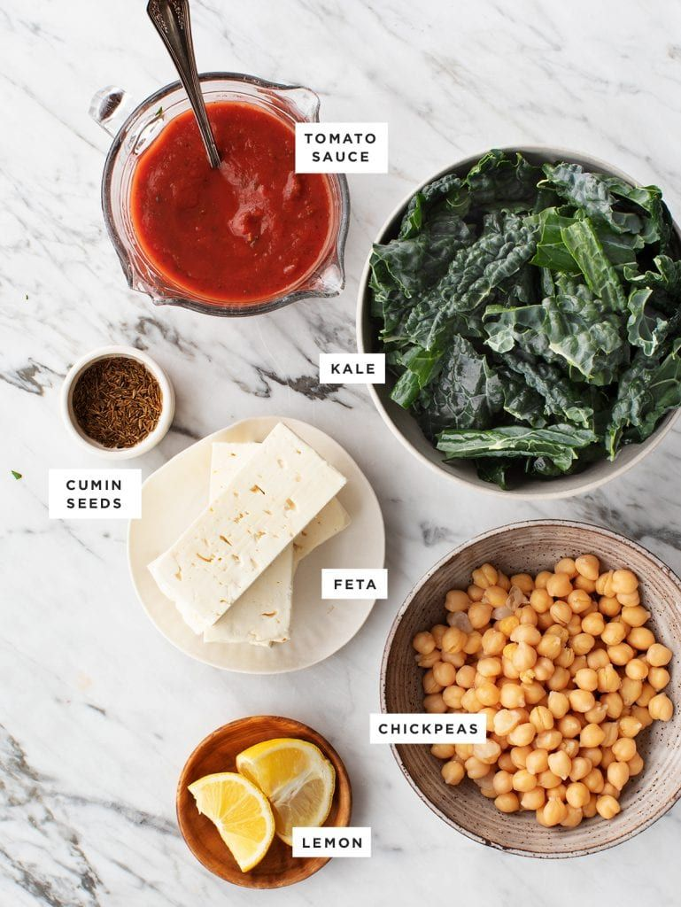 This baked feta is the easiest vegetarian dinner Great for cold weeknights its a simple 8ingredient recipe made with cuminspiced tomato sauce chickpeas and kale  Love and...