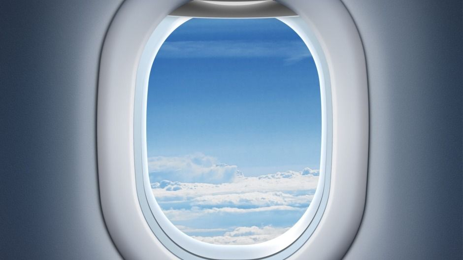 Why flight attendants tell you to close your window shade on planes