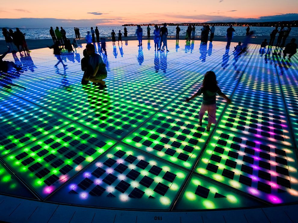 Public art piece Greeting to the Sun lights up in harmony with the waves of the Adriatic in Zadar, Croatia. Created by Croatian architect Nikola Bašić. Photograph by Cogoli Franco, SIME #lightartinstallation