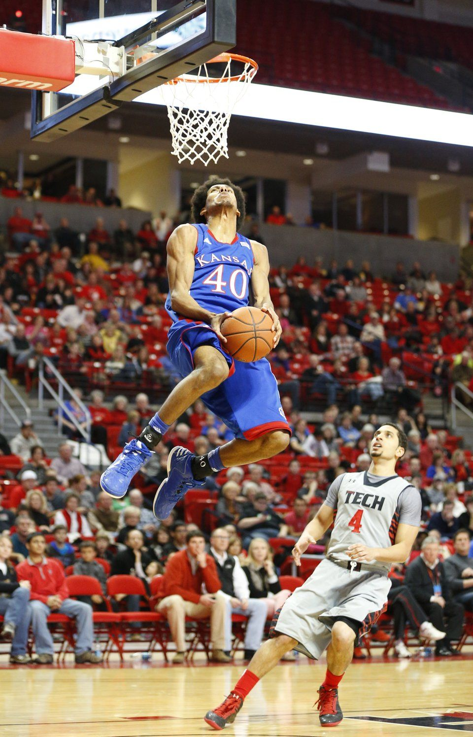 Kansas forward Kevin Young soars in for a reverse jam 1