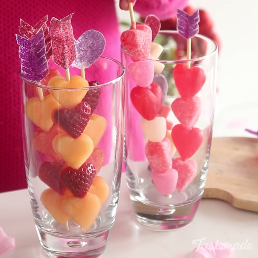"Celebrate ""Galentine's Day"" with fresh fruit and gummies skewered onto festive Cupid's arrows. Save the recipe on our app! http://link.tastemade.com/HE7m/H1wHe4m2mA"